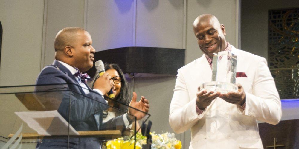 Oakwood Univesity Senior Pastor Carlton Byrd gives Johnson an award...