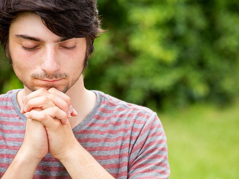Single Andrews seminarian praying for growth of Department of Nursing